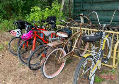 A collection of bicycles in a bike rack