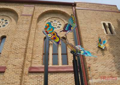 An outdoor art display of colorful butterfly sculptures in Lakeville MN