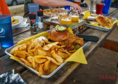 A fresh pork loin sandwich and potato chips at Lakeville Brewing Company