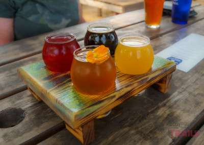 A flight of four beers on a picnic table at Lakeville Brewing Company