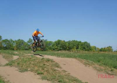 A man rides a mountain bike on a dirt trail at West Lake Marion Mountain Bike Trails