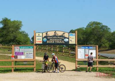 People gather at the front gate of West Lake Marion Mountain Bike Trails