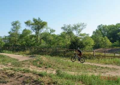 A man rides a mountain bike on a dirt trail