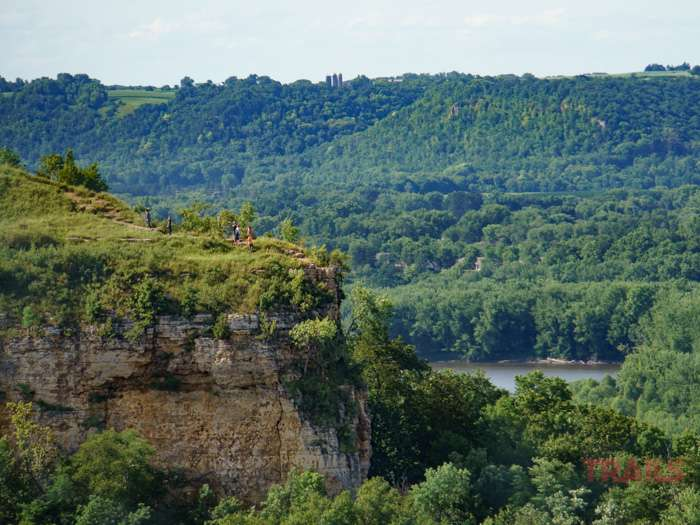 A view of Red Wing's Barn Bluff from Memorial Park reveals hikers atop the steep cliff