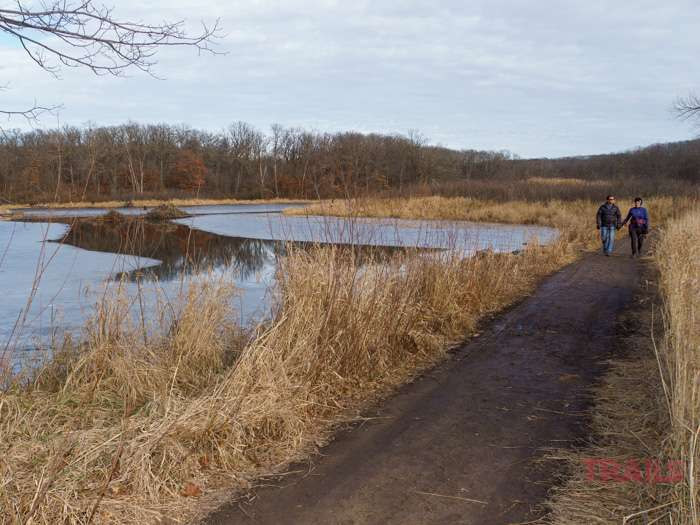 A couple hike the Big Woods Loop Trails at Lake Maria State Park on a chilly fall day